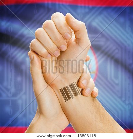 Barcode Id Number On Wrist And National Flag On Background - Guam