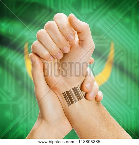 Barcode Id Number On Wrist And National Flag On Background - Mauritania