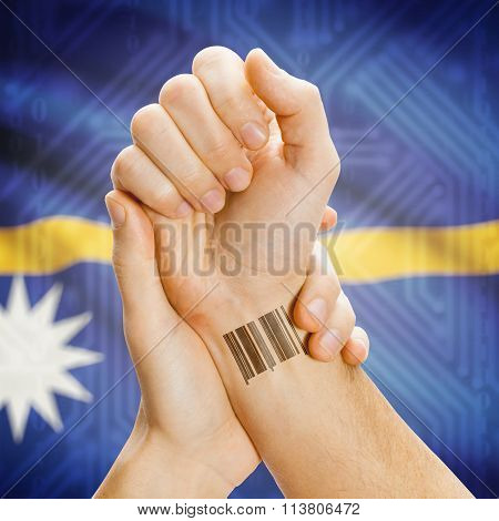 Barcode Id Number On Wrist And National Flag On Background - Nauru