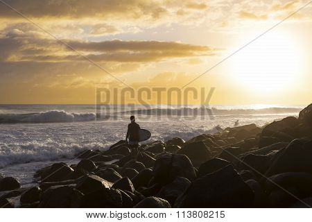 Sunrise surfer silhouette