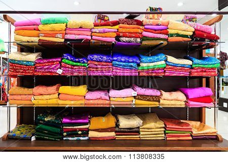 Pile Of Colorful Fabrics On Shelves