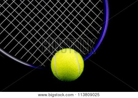Tennis Racquet And Ball On Black Background
