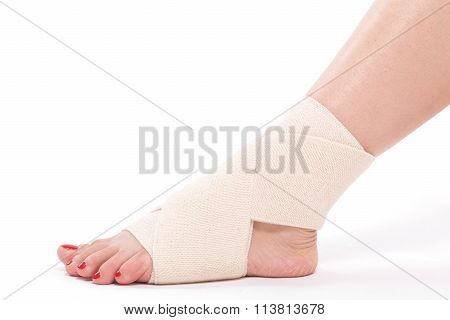 Studio Shot Female Ankle Tied With An Elastic Bandage