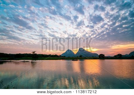 Reflection Of Beautiful Nature Landscape By The Lakeside In Tropical Country During Sunrise