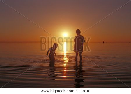 Brothers Playing In The Water At The Great Salt Lake Beach At An