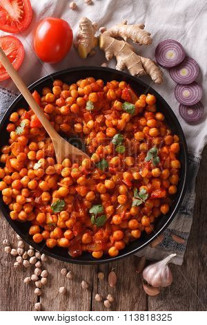 Indian Chana Masala With Ingredients Close-up. Vertical Top View