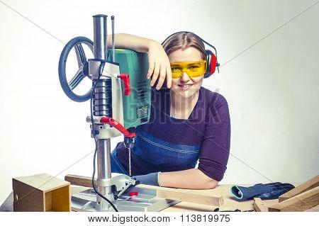 Female Carpenter And Drilling Machine.