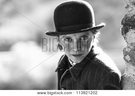 Woman dressed as Charlie Chaplin man style