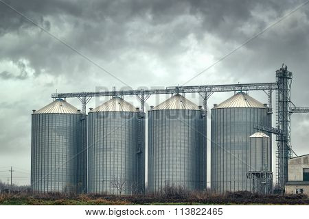 Grain Silos On Cloudy Day