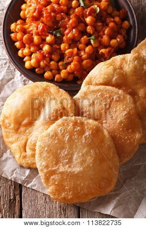 Indian Puri And Chana Masala Close-up On The Table. Vertical Top View