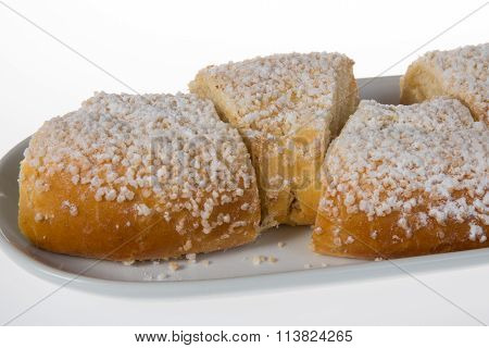 French King Cake On A Wooden Stand. On A White Background. Close-up.