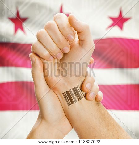 Barcode Id Number On Wrist And Usa States Flags On Background - District Of Columbia