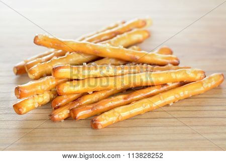 a group pretzel rods (stick) on wooden table
