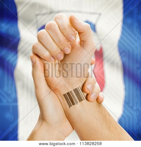 Barcode Id Number On Wrist With Canadian Province Flag On Background - Northwest Territories