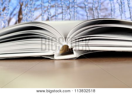 Open Book On A Wood Table  Over Blue Winter   Light Background