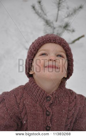 girl catching snow on tongue