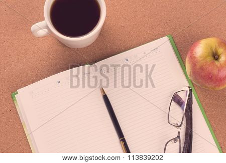 Closeup To Agenda And Coffee