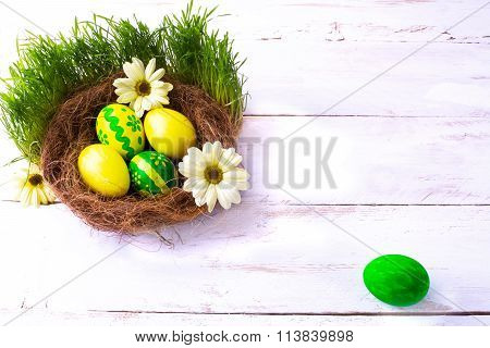 Yellow And Green Easter Eggs In A Nest