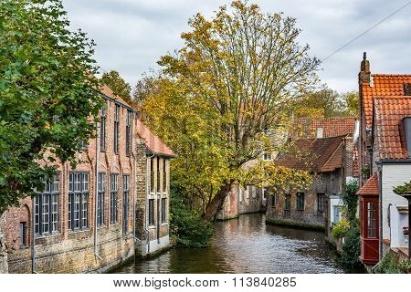 Medieval houses over the canal in Bruges on a cloudy day
