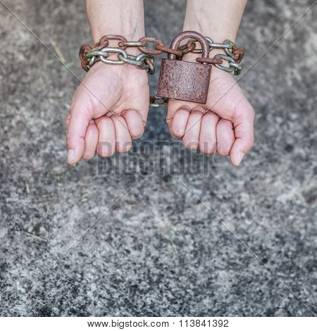 Closeup Woman With Chained Hands And Padlock