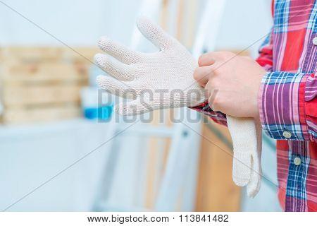 Handsome man doing renovation
