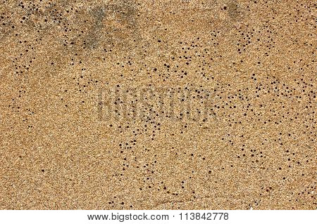 closeup sand pattern of beach in the summer