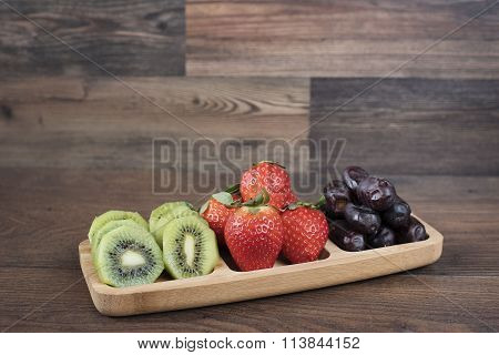 Strawberries, Kiwi and Dates in a Bamboo Plateau