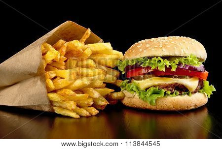Big Cheeseburger With French Fries On Black Board