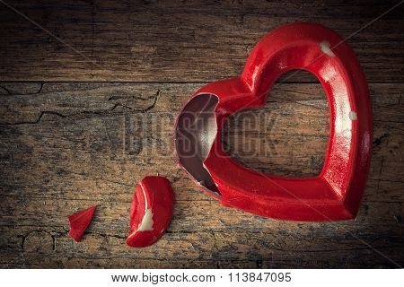 Valentine Broken Heart On A Wooden Background