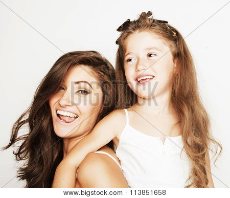 young mother with little cute daughter on white, happy smiling family inside isolated