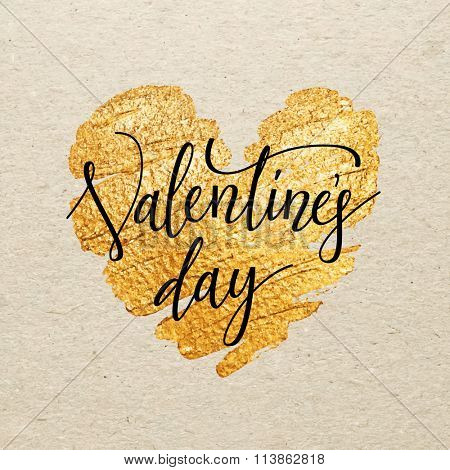 Valentines day card. Calligraphy lettering with gold paint heart on craft background. Hand drawn letters.