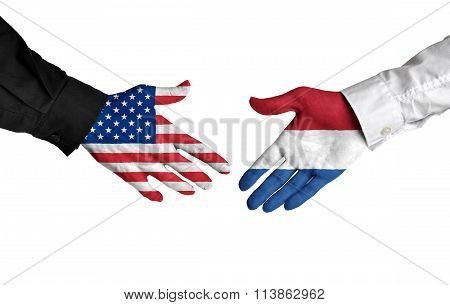 United States and Netherlands leaders shaking hands on a deal agreement