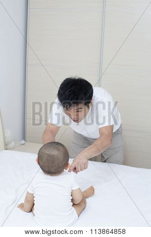Tender Moment Between Chinese Father And Son