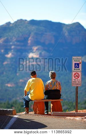 Elderly couple enjoying with beautiful Sedona's red rocks view.