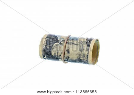 Roll Of Dollar Banks Note On White Background