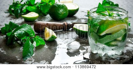 Fresh Mojito With Lime And Mint On The Stone Table.