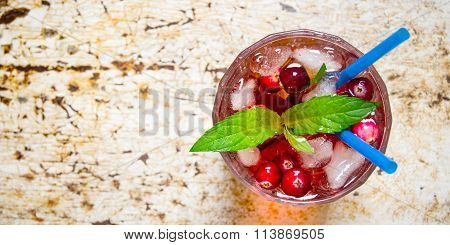 Berry Cocktail In Glass With Ice And Mint On Old Table.  Free Space For Text.