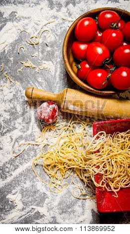 Noodles With Tomatoes In A Cup And Rolling Pin.