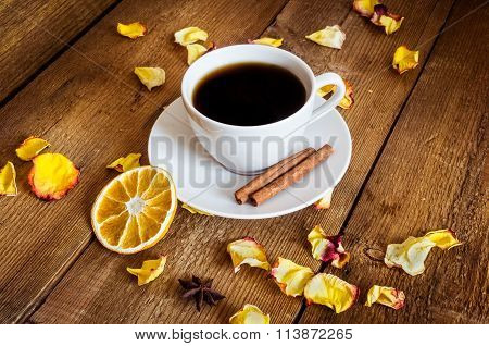 Cup Of Tea, Dried Orange, Dried Yellow Rose Petals On Wooden Background