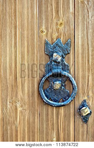 Door wooden with forged handle