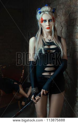 Blonde Girl Holding A Samurai Sword.