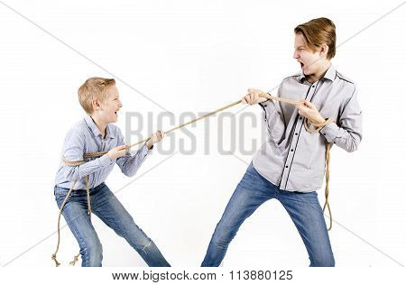 Caucasian Siblings Boys Pulls Rope