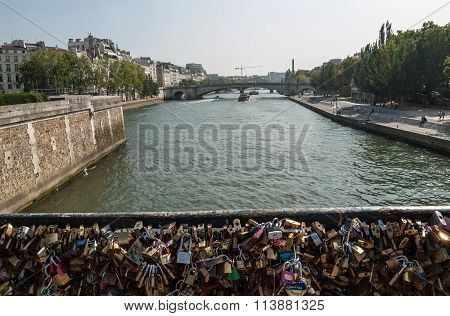 PARIS, FRANCE - SEPTEMBER 8, 2014: Paris - Pont de l'Archeveche (Archbishop's Bridge)covered with love padlocks. The Pont de l'Archeveche is the narrowest road bridge in Paris