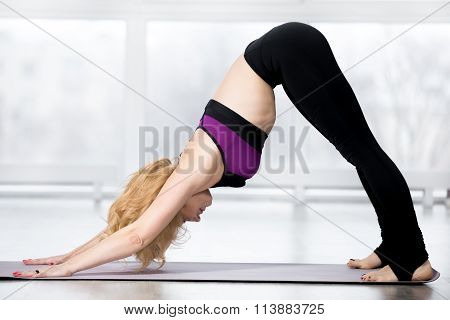 Senior Woman Doing Adho Mukha Svanasana
