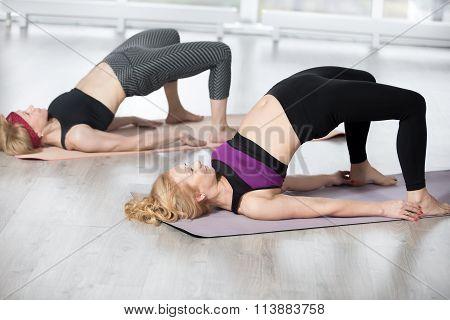 Senior Women Doing Shoulder Bridge Exercise