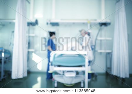 Doctors At The Bedside Of The Patient, Medical Background Defocused