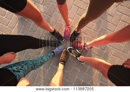 Legs Of Athletes In A Circle