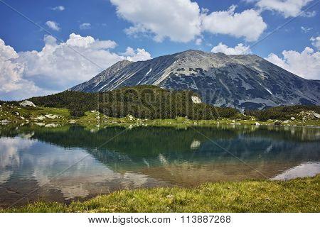 Amazing Panorama of Todorka Peak and reflection in Muratovo lake, Pirin Mountain