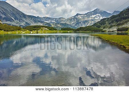 Amazing view of  Banderishki Chukar peak and reflection in Muratovo lake, Pirin Mountain