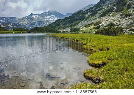 Amazing Panorama of  Banderishki Chukar peak and reflection in Muratovo lake, Pirin Mountain